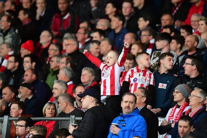 Lincoln City fans during the first half<br /> <br /> Photographer Chris Vaughan/CameraSport<br /> <br /> Vanarama National League - Lincoln City v Torquay United - Friday 14th April 2016  - Sincil Bank - Lincoln<br /> <br /> World Copyright &copy; 2017 CameraSport. All rights reserved. 43 Linden Ave. Countesthorpe. Leicester. England. LE8 5PG - Tel: +44 (0) 116 277 4147 - admin@camerasport.com - www.camerasport.com