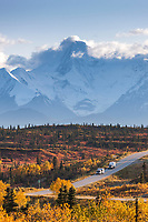 Vehicles travel the Richardson Highway through the Alaska Range mountains, Interior, Alaska.