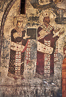 Picture &amp; image of Vardzia medieval cave Church of the Dormition interior secco paintings of Queen Tamar &amp; Giorgi III, part of the cave city and monastery of Vardzia, Erusheti Mountain, southern Georgia (country)<br /> <br /> Inhabited from the 5th century BC, the first identifiable phase of building took place at  Vardzia in the reign of Giorgi III (1156-1184) to be continued by his successor, Queen Tamar 1186, when the Church of the Dormition was carved out of the rock and decorated with frescoes