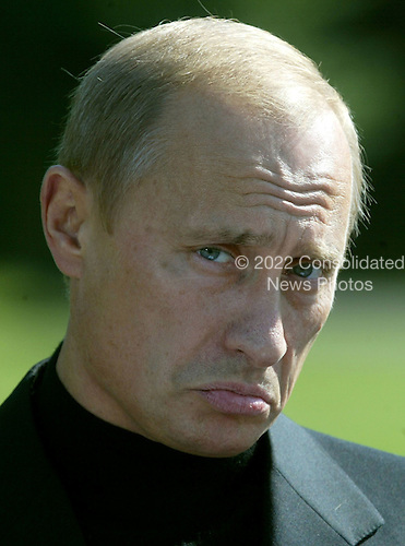President Vladimir Putin of Russia attends a news conference with United States President George W. Bush September 27, 2003 at Camp David, Maryland. Putin arrived September 26 after attending official meetings at the United Nations in New York. .Credit: Mark Wilson - Pool via CNP..