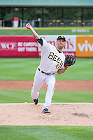 Frank Herrmann (40) of the Salt Lake Bees delivers a pitch to the plate against the Tacoma Rainiers in Pacific Coast League action at Smith's Ballpark on May 7, 2015 in Salt Lake City, Utah. The Bees defeated the Rainiers 11-4 in the completion of the game that was suspended due to weather on May 6, 2015. (Stephen Smith/Four Seam Images)