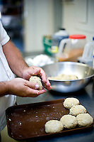Vince O'Neal prepares crabcakes at Pony Island restaurant.