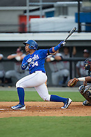 Xavier Fernandez (34) of the Burlington Royals follows through on his swing against the Danville Braves at Burlington Athletic Park on July 12, 2015 in Burlington, North Carolina.  The Royals defeated the Braves 9-3. (Brian Westerholt/Four Seam Images)