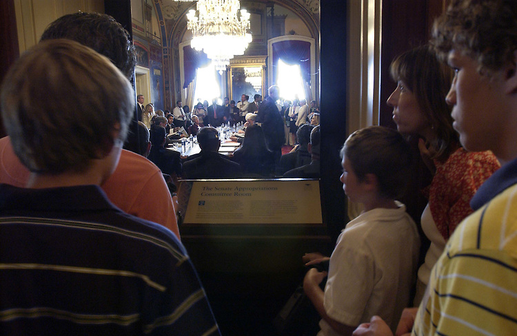 06/21/05.SENATE APPROPRIATIONS/CJS--On a staff tour with Sen. Jim Talent's office, the Jendrycki family, of St. Louis, Mo.., looks in on the Senate Appropriations Subcommittee on Commerce, Justice and Science markup of a draft bill. The meeting was in S-128 of the U.S. Capitol..CONGRESSIONAL QUARTERLY PHOTO BY SCOTT J. FERRELL