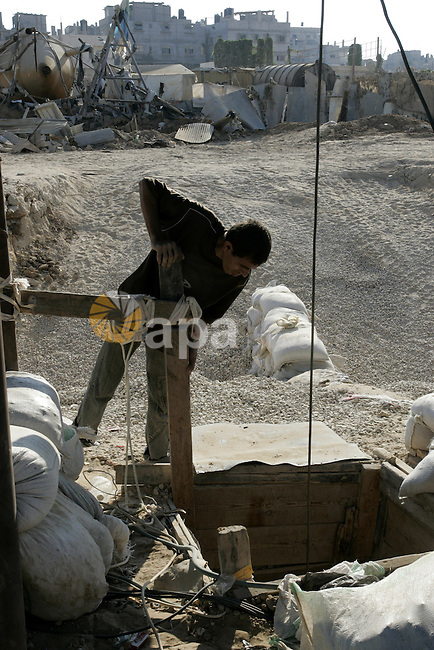 A Palestinian inspects the damage to a smuggling tunnel after it was targeted in an Israeli air strike in Rafah, in the southern Gaza Strip August 19, 2011. Israeli aircraft struck Hamas security installations in Gaza on Friday, killing at least one Palestinian, in further retaliation for attacks along the Egyptian border in which eight Israelis died. Photo by Abed Rahim Khatib