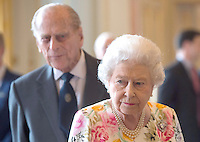 14 July 2016 - Queen Elizabeth II and Prince Philip the Duke of Edinburgh during a reception for the winners of  The Queen's Awards for Enterprise 2016 at Buckingham Palace in central London. Winners of The Queen's Awards for Enterprise 2016 which recognise excellence in international trade, innovation and sustainable development were joined by the Queen at the celebration on Thursday evening. More than 500 guests, including representatives from 254 winning companies, were at the event. Photo Credit: ALPR/AdMedia