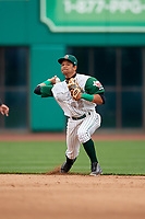 Fort Wayne TinCaps shortstop Reinaldo Ilarraza (12) throws to first base during a game against the Wisconsin Timber Rattlers on May 10, 2017 at Parkview Field in Fort Wayne, Indiana.  Fort Wayne defeated Wisconsin 3-2.  (Mike Janes/Four Seam Images)