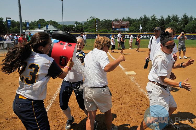 30 MAY 2011: University of California San Diego Coach Patti Gerckens gets soaked after leading the Tritons to their first softball championship during the Division II Women's Softball Championship held at the James I. Moyer Sports Complex in Salem, VA. UC San Diego defeated Alabama-Huntsville 10-3 to win the national title.  Andres Alonso/ NCAA Photos