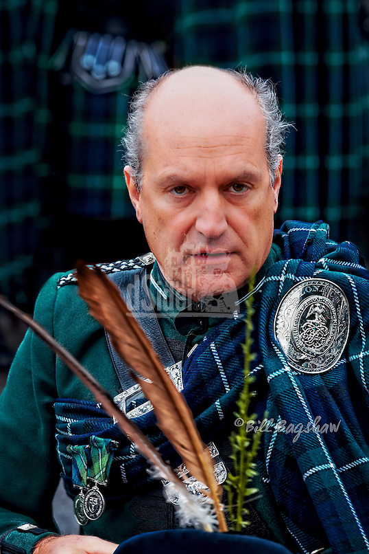 Lonach. Sir James Forbes patron of Lonach Friendly Society dons his feathered cap to commence Lonach March. Lonach gathering commences with Lonach March followed by Lonach Highland Games. dsider.co.uk online magazine, photography courses Aberdeenshire