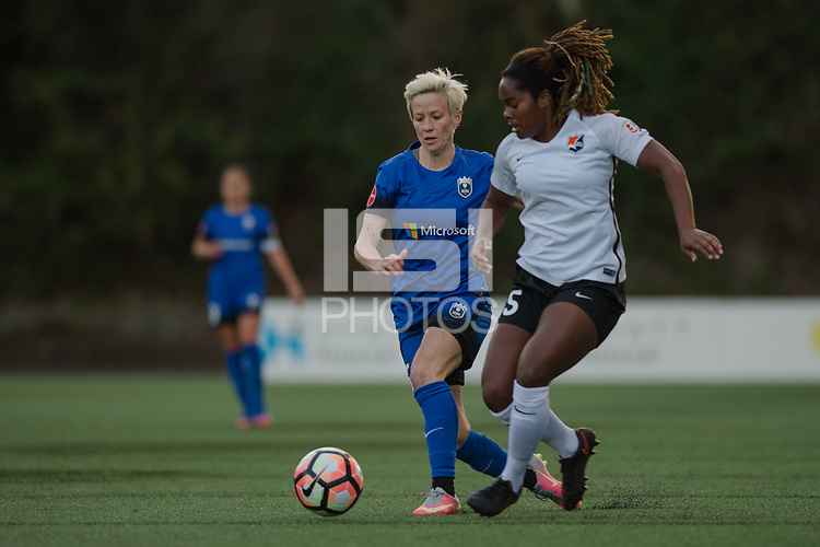 Seattle, WA - April 15th, 2017: Megan Rapinoe and Kayla Mills during a regular season National Women's Soccer League (NWSL) match between the Seattle Reign FC and Sky Blue FC at Memorial Stadium.