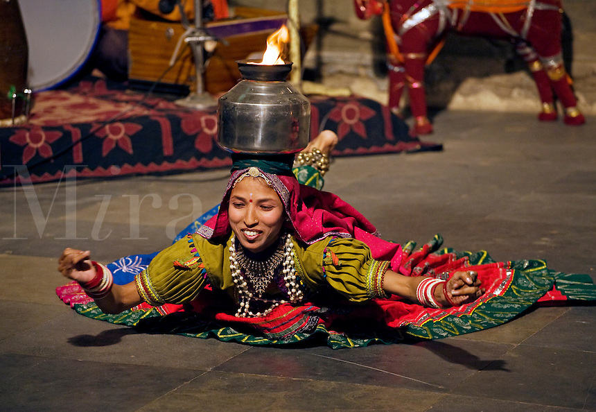 A Rajasthani woman performs a traditional DANCE with a flaming pot on her head at the BAGORE KI HAVELI in UDAIPUR - RAJASTHAN, INDIA