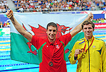 The podium in men's 200m freestyle final, from left, third placed Wales' Calum Jarvis and winner Australia's Thomas Fraser-Holmes<br /> <br /> Photographer Chris Vaughan/Sportingwales<br /> <br /> 20th Commonwealth Games - Day 2 - Friday 25th July 2014 - Swimming - Tollcross International Swimming Centre - Glasgow - UK