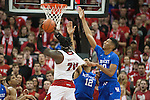 Center Marcus Lee of the Kentucky Wildcats goes up for a block during the game against  the Louisville Cardinals at KFC Yum! Center on Saturday, December 27, 2014 in Louisville `, Ky. Kentucky leads Louisville 22-18 at halftime. Photo by Michael Reaves | Staff