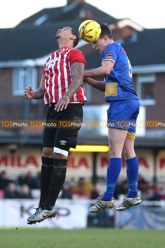 Leon McKenzie of Hornchurch rises with Ryan Mallett of Romford during AFC Hornchurch vs Romford, Ryman League Division 1 North Football at Hornchurch Stadium on 4th February 2017