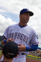 Round Rock Express third baseman Mike Olt #20 signs autographs before the game against the New Orleans Zephyrs in the Pacific Coast League baseball game on April 21, 2013 at the Dell Diamond in Round Rock, Texas. Round Rock defeated New Orleans 7-1. (Andrew Woolley/Four Seam Images).