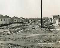 1941  March  06..Merrimack Landing   ..Merrimack Park.Defense Housing Project VA-6-1.Looking West along roadway between D-1-17 &  D-1-20.#20...NEG#.3508..