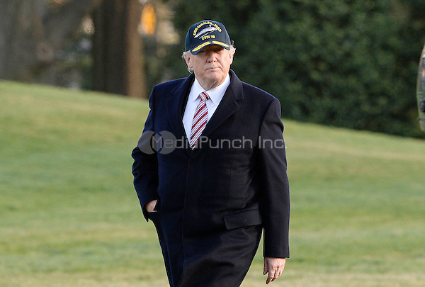 United States President Donald J. Trump walks back to the Oval Office as he returns to the White House on March 2, 2017 in Washington, DC. <br /> Credit: Olivier Douliery / Pool via CNP /MediaPunch