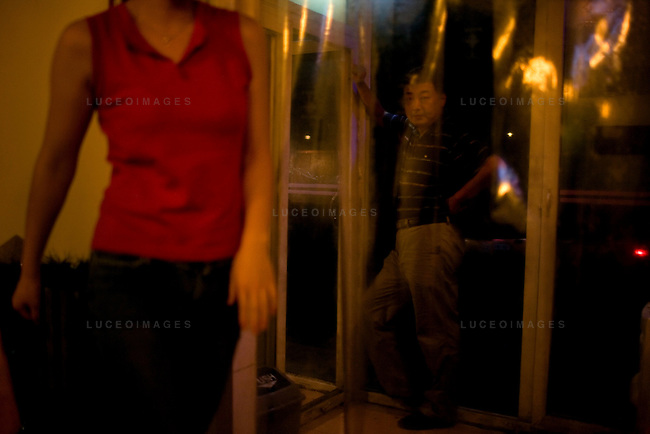 Restaurant workers wait for customers in Beijing, China on Thursday, August 21, 2008.  Kevin German