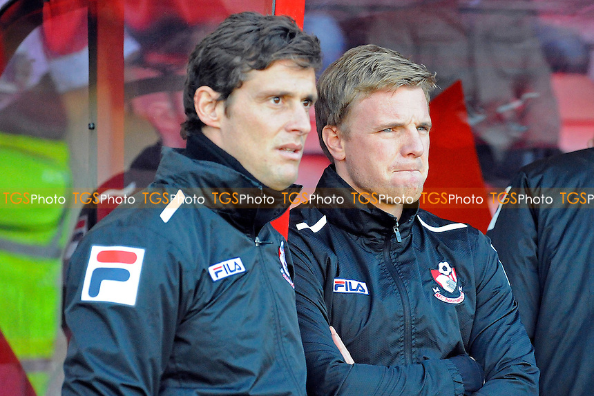 AFC Bournemouth Assistant Manager Jason Tindall and AFC Bournemouth Manager Eddie Howe - AFC Bournemouth vs Yeovil Town - Sky Bet Championship Football at the Goldsands Stadium, Bournemouth, Dorset - 26/12/13 - MANDATORY CREDIT: Denis Murphy/TGSPHOTO - Self billing applies where appropriate - 0845 094 6026 - contact@tgsphoto.co.uk - NO UNPAID USE