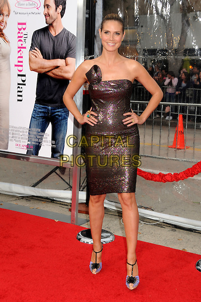 """HEIDI KLUM.""""The Back-up Plan"""" Los Angeles Premiere held at the Regency Village Theatre, Westwood, California, USA,.21st April 2010..arrivals full length strapless brown shimmery shiny sparkly bronze dress christian louboutin shoes sandals high heels blue t-bar cork black sequined sequin blue t-bar cork black platform peep toe green khaki pink hands on hips .CAP/ADM/BP.©Byron Purvis/AdMedia/Capital Pictures."""