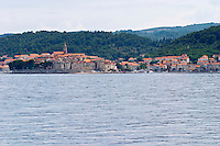 View across the sea on the town of Korcula on the island of the same name where Marco Polo was born Korcula Island. Dalmatian Coast, Croatia, Europe.