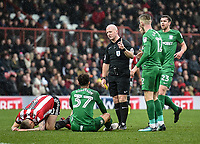 Referee Simon Hooper has words with Preston's Callum Robinson with Paul Gallagher and Brentford's Josh McEachran<br /> <br /> Photographer Jonathan Hobley/CameraSport<br /> <br /> The EFL Sky Bet Championship - Brentford v Preston North End - Saturday 10th February 2018 - Griffin Park - Brentford<br /> <br /> World Copyright &copy; 2018 CameraSport. All rights reserved. 43 Linden Ave. Countesthorpe. Leicester. England. LE8 5PG - Tel: +44 (0) 116 277 4147 - admin@camerasport.com - www.camerasport.com