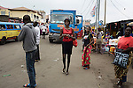 KINSHASA, DRC - JULY 17: Vanessa Nsul Kilem, age 21, walks on the street close to her home in Petro Congo district of Kinshasa on July 17, 2014. She dreams of becoming a super model. She has won local beauty pageants and she was one of 2000 girls casting for the thirty spots to participate in Kinshasa Fashion Week at Shark club in Kinshasa, DRC. Local and invited foreign-based designers showed their collections during the second edition of Kinshasa Fashion week. (Photo by Per-Anders Pettersson)