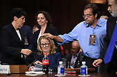 Christine Blasey Ford, the woman accusing Supreme Court nominee Brett Kavanaugh of sexually assaulting her at a party 36 years ago, is comforted by her attorneys and a witness before the US Senate Judiciary Committee on Capitol Hill in Washington, DC, September 27, 2018.  / POOL / SAUL LOEB