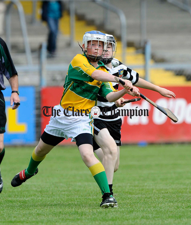 Feakle/Killanena's  Jason Keehan is tackled by Clarecastle's Paul Dolan during their U-12B final at Cusack Park. Photograph by John Kelly.