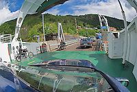 Blue car prepares to depart ferry after fjord crossing, Norway