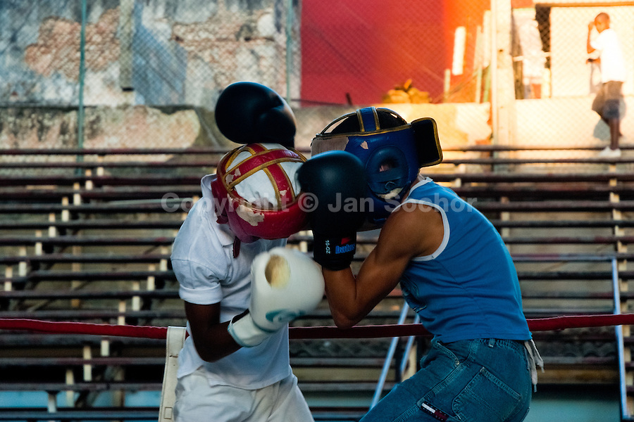 Young Cuban boys during a heavy training fight at Rafael Trejo boxing gym in Havana, Cuba, 13 February 2010. During the last 30 years Cuba has produced more World Champions and Olympic gold medallists in amateur boxing than any other country. Many famous fighters, who came out of Cuba, were training at Rafael Trejo boxing gym in their youth. This run down open air facility in the Old Havana is a place of learning and mastering the art of boxing by the old school style. Boys begin their training very young. As sports are given a high political priority in Cuba, all children are systematically encouraged to develop their skills. Those who succeed will become heroes of Cuban society.