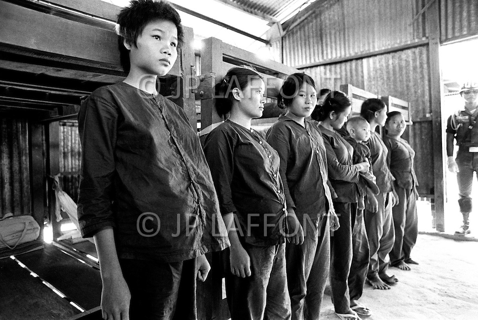 Bien Hoa, Vietnam. April 1970. Businessman Ross Perot, founder of Electronic Data Systems, Inc., visits a Prisoners of War camp in Bien Hoa, South Vietnam for North Vietnamese women who were captured with weapons. Some of the women are pregnant or have had their babies in prison. Perot was appointed by United States Secretary of the Navy John Warner to report on the conditions of Americans in Vietnamese and Laotian POW camps for four years, until the prisoners were released in 1972 at the end of the Vietnam War.