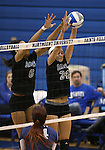 Marymount's Cailyn Thomas and Emileigh Rettig block in a college volleyball game, in Arlington, Vir., on Saturday, Nov. 1, 2014.<br /> Photo by Cathleen Allison