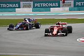 29th September 2017, Sepang, Malaysia;  Motorsports: FIA Formula One World Championship 2017, Grand Prix of Malaysia, #10 Pierre Gasly (FRA, Scuderia Toro Rosso), #7 Kimi Raikkonen (FIN, Scuderia Ferrari),