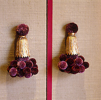 A detail of the wardrobe handles in the dressing room which have been made of purple and golden tassels