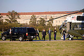 United States President George W. Bush and first lady Laura Bush make their way to their vehicle after exiting Marine One after landing on the grounds of the Washington Monument as Bush returns to Washington on October 6, 2008. <br /> Credit: Kevin Dietsch / Pool via CNP