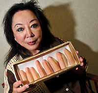 Platic surgeon Maria Niino, holds prosthetic fingers that she makes for Yakuza (Japanese gangsters) who have had to cut their own fingers off as a punishment from their crime bosses in Tokyo Japan, Thursday 4th June.   The fingers are provided to those Yakuza who want to hide their criminal past.<br />