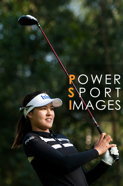 In-Gee Chun of Korea plays a shot during the Hyundai China Ladies Open 2014 at World Cup Course in Mission Hills Shenzhen on December 14 2014, in Shenzhen, China. Photo by Xaume Olleros / Power Sport Images