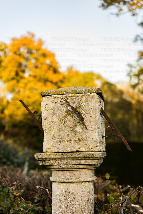 Old stone sundial in a garden in England