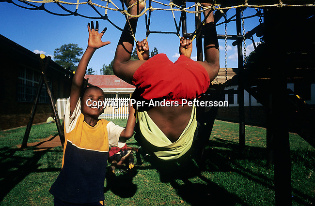 Blind boys play in a playground on April 17, 2003 at Sibonile (means: we have seen) School for the Blind in Klipriver, south of Johannesburg, South Africa. A blind woman founded the school in 1994. The school has about 125 students from disadvantaged communities around South Africa. Many of the children have faced rejection from their families and communities, and at Sibonile they have a chance for a good education. (Photo by: Per-Anders Pettersson)..