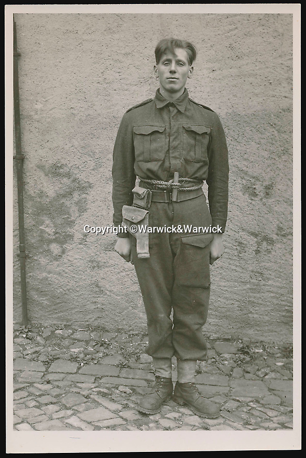 BNPS.co.uk (01202 558833)<br /> Pic: Warwick&Warwick/BNPS<br /> <br /> Rifleman Cyril Abram at Colditz - He was captured after the successful Operation Musketoon commando raid on a Norwegian power station and later executed under Hitler's notorious 'Commando Order' in Sachsenhausen concentration camp near Berlin.<br /> <br /> A remarkable archive of photos which provide a glimpse inside the infamous Colditz Castle has come to light.<br /> <br /> The photos show the ingenuity of the Allied POWs who devised ever-bolder ways to escape from the German stronghold during World War Two.<br /> <br /> One image is of a dummy they would hold up to trick the German guards into believing the escaper was still with them during parade head counts. Others reveal the tunnels which were dug using tools smuggled into the 11th century castle in care parcels.<br /> <br /> The photos were taken by the official Colditz photographer Johannes Lange, who was employed by the German Army to take pictures of failed Allied escape attempts. They were then distributed to other POW camps to alert the guards to the methods the inmates were using in their bids for freedom.<br /> <br /> The archive is being sold by a private collector with auctioneer Warwick & Warwick, with an estimate of £1,750.