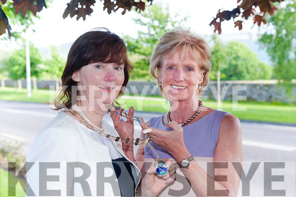 Incoming Killarney Soroptimist President Emer Moynihan, left, receives the chain of office from outgoing President Clair Bowler at The Gleneagle Hotel, Killarney on Tuesday night.