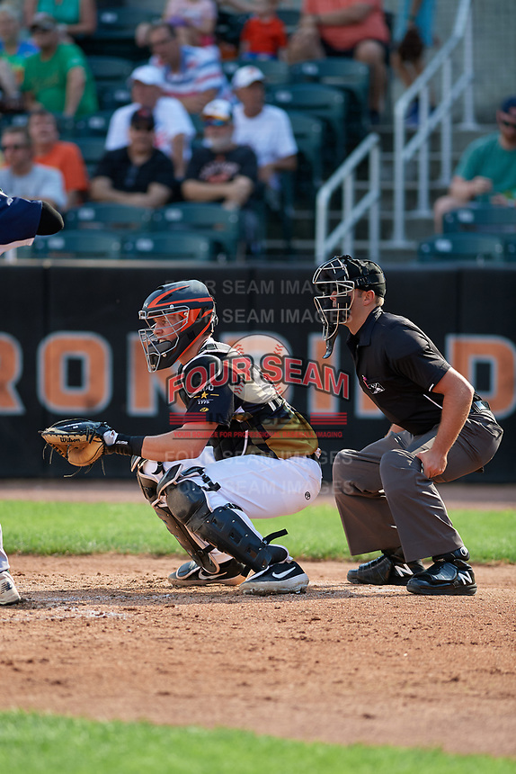 Aberdeen IronBirds catcher Adley Rutschman (35) and umpire Paul Roemer await the pitch during a NY-Penn League game against the Vermont Lake Monsters on August 18, 2019 at Leidos Field at Ripken Stadium in Aberdeen, Maryland.  Vermont defeated Aberdeen 6-5.  (Mike Janes/Four Seam Images)