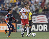 New York Red Bulls forward Fabian Espindola (9) on offense. In a Major League Soccer (MLS) match, the New England Revolution (blue) tied New York Red Bulls (white), 1-1, at Gillette Stadium on May 11, 2013.