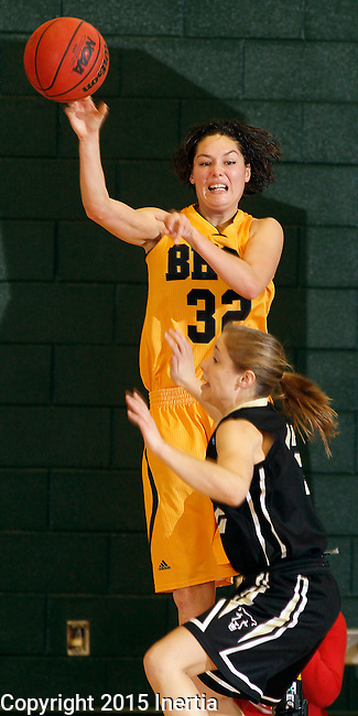 JANUARY 23, 2015 -- Dakota Barrie #32 of Black Hills State passes over UC-Colorado Springs defender McKenna Haist #12 during their Rocky Mountain Athletic Conference women's basketball game Friday at the Donald E. Young Center in Spearfish, S.D.  (Photo by Dick Carlson/Inertia)