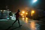 Newport, United States. 11th February 2013 -- A man jogs during a foggy night at Newport in New Jersey. Photo by Eduardo Munoz Alvarez / VIEWpress.
