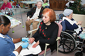 "Yolanda Joseph activities asst. at The Greenwood House Home for the Jewish Aged in Ewing, New Jersey gives a manicure to Rose Glantz  on Thursday February 17, 2005.....The Greenwood House is 70 % Medicaid yet everyone is treated the same. The staff to patient ratio mandate per hour per resident on medicaid is 2.5, at The Greenwood House it is 3.5 hours. If facilities provided the minmum care, mandated by medicaid, states would penalize nursing care homes. If medicaid is cut, the staff to patient ratio is cut also. ""It's a Catch-22"", states Rick Goldstein director of The Greenwood House Home for the Jewish Aged...Each year the Greenwood House has a $500,000 deficit from medicaid that must be made up. This is done with fundraisers, galas and annual memberships.  Jane Therese/Sipa.."