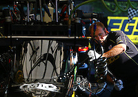 Aug. 3, 2014; Kent, WA, USA; A crew member works on the engine for NHRA top fuel dragster driver Richie Crampton during the Northwest Nationals at Pacific Raceways. Mandatory Credit: Mark J. Rebilas-Sports