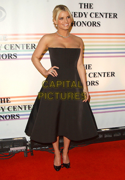 JESSICA SIMPSON.Arrivals - 29th Annual Kennedy Center Honors, .held at the John F. Kennedy Center for the Performing Arts, Washington, D.C. USA, 03 December 2006..full length strapless black prom dress shoes hands on hips.CAP/ADM/GS.©George Shepherd/AdMedia/Capital Pictures