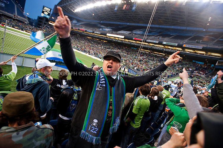 3/28/2009--Seattle, WA, USA..Sean McConnell of the Emerald City Supporters club leads fans of the Seattle Sounders FC in chants during the game against Real Salt Lake at Qwest Field in Seattle. The Seattle Sounders FC beat Real Salt Lake city 2-0 in their second game of the season played to a soldout crowd of 28,548 at Qwest Field..©2009 Stuart Isett. All rights reserved.
